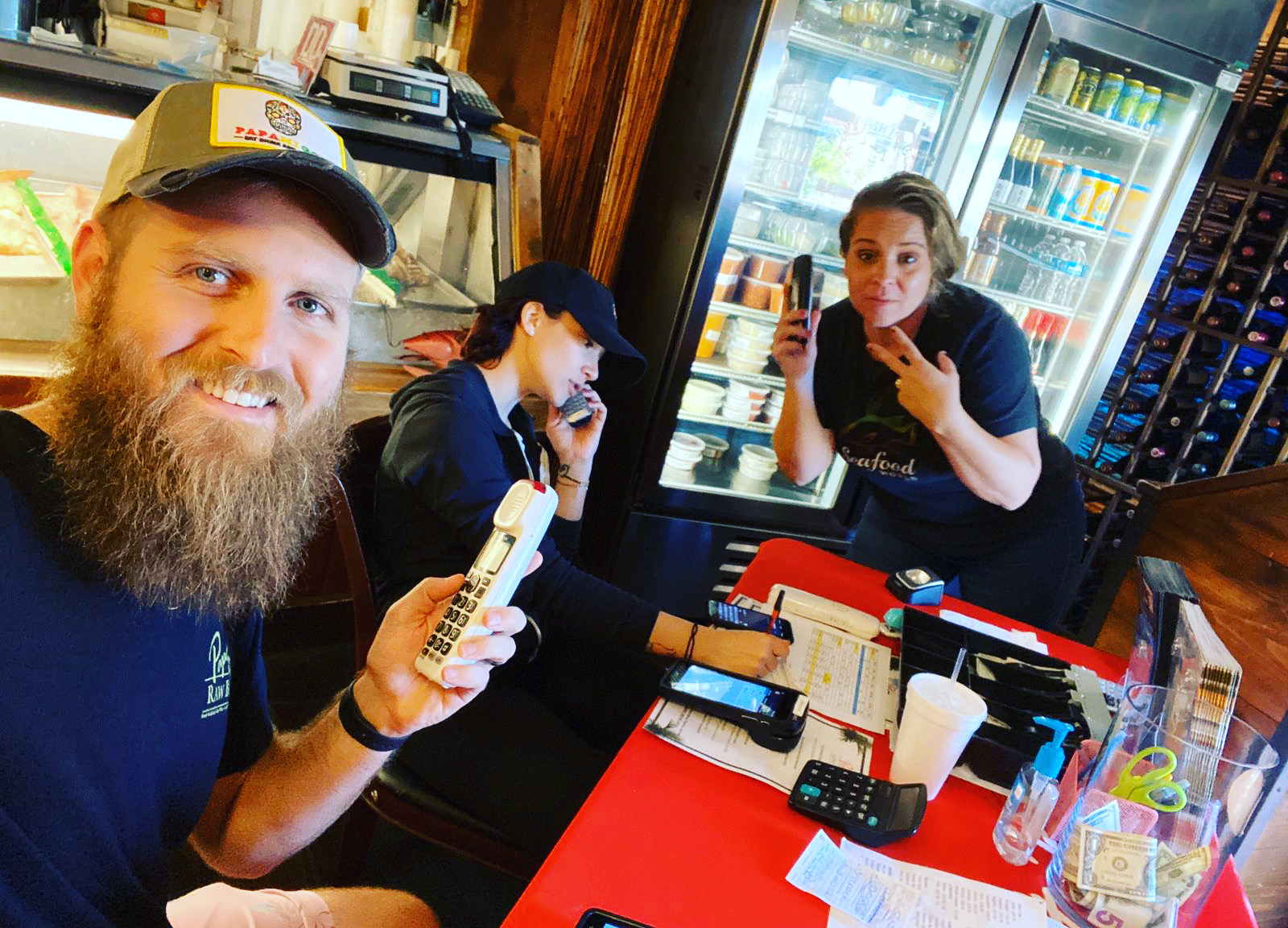 Papa's Raw Bar staff answering phones for takeout orders