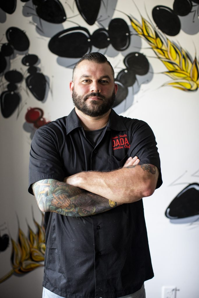 Chef Jessie Steele posing inside Dada in Delray Beach