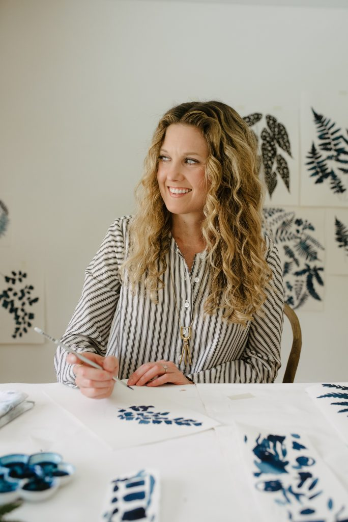 Jenny Kiker of Living Pattern painting in her studio