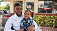 Anthony Barber at Troy's Barbeque with his son